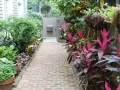 brick walkway with tropical beds